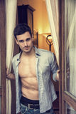 Sexy young man with shirt open on muscular chest Royalty Free Stock Photos