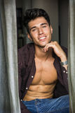 Sexy young man with shirt open on naked muscular torso Royalty Free Stock Photos
