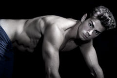 young man shirtless. Gym muscular body. Quadruped position. On all fours. Royalty Free Stock Images