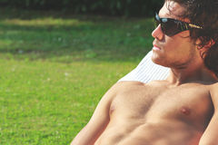 Sexy young man sunbath Royalty Free Stock Image
