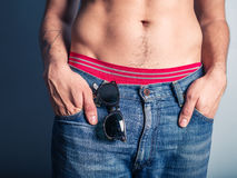 Sexy young man with sunglasses in his pocket Stock Images