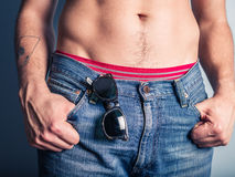Sexy young man with sunglasses in his pocket Royalty Free Stock Photos