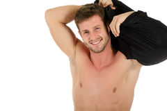 young man, undressing Stock Image