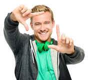 Sexy young man wearing headphones framing photograph isolated on Royalty Free Stock Photography