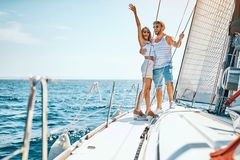 Sexy man and woman on the luxury boat stock photos