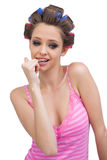 Sexy young model posing wearing hair curlers Royalty Free Stock Photography