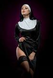 Nun. Young nun posing indoors stock photo