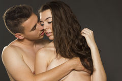 Sexy young passion couple on gray isolated Stock Photos