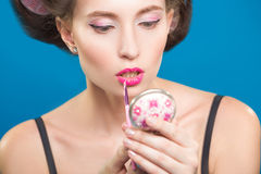Sexy young pin-up girl doing make-up Royalty Free Stock Photo
