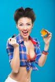 young pin-up girl doing make-up Stock Image