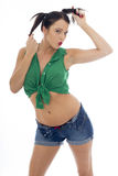 Sexy Young Pin Up Model Wearing a Green Tied Top And Blue Shorts Royalty Free Stock Image