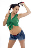 Sexy Young Pin Up Model Wearing a Green Tied Top And Blue Shorts Stock Photography