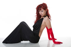 Sexy young red-haired  in black evening dress Royalty Free Stock Photo