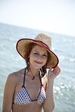 young red-haired girl on the beach Stock Images