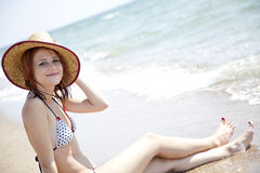 young red-haired girl on the beach Royalty Free Stock Images