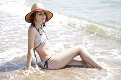 Sexy young red-haired girl on the beach Stock Photos