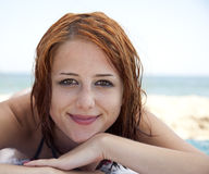 Sexy young red-haired girl on the beach Stock Photo
