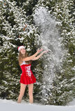 young Santa-girl in winter fir forest Stock Image