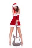 Sexy young santa woman with guitar Stock Photos