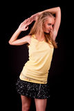 Sexy young tall blonde in yello shirt Stock Images