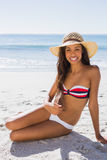 Sexy young tanned woman wearing straw hat posing Royalty Free Stock Photo