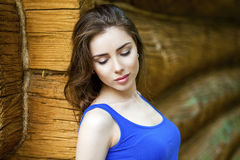 young woman, against the background of the old wooden board royalty free stock image