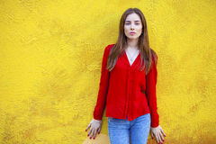Sexy young woman, against the background of the yellow wall Stock Photo