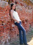 Sexy young woman against a brick wall Royalty Free Stock Photography