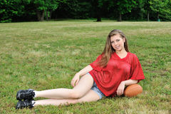 Sexy young woman - American Football Stock Photo