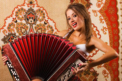 Sexy young woman on asian carpet background Stock Images