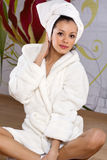 Young woman in a bathrobe. Beautiful royalty free stock images