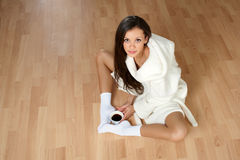 Sexy young woman in a bathrobe Royalty Free Stock Photography