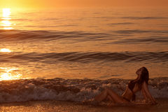 young woman at the beach during sunset Royalty Free Stock Images