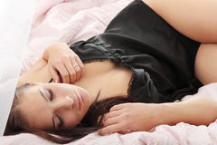 Sexy young woman in bed Stock Image