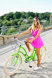 young woman with bicycle Stock Photography