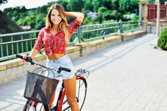 Sexy young woman on a bicycle posing outdoor Royalty Free Stock Image