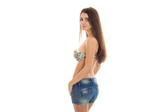 Sexy young woman with big natural breasts in swimsuit and jeans shorts looking at the camera isolated on white Royalty Free Stock Photos
