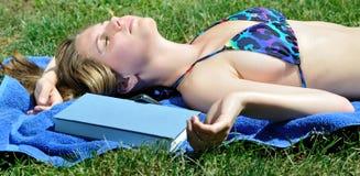 young woman in bikini - napping outside Stock Photo