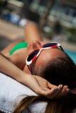 Sexy young woman in bikini sunbathing Stock Photos