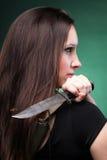 Sexy young woman long hair - gun knife Royalty Free Stock Photos