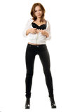 young woman in black tight jeans stock images