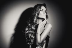 young woman black and white portrait. Seductive young woman with long hair posing royalty free stock images