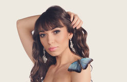 Sexy young woman with butterfly Stock Photos