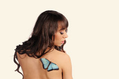 Sexy young woman with butterfly Stock Image