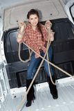 Sexy young woman in cargo van Stock Photo