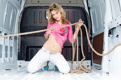 Sexy young woman in cargo van Stock Photos