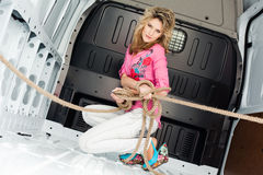 young woman in cargo van inside Stock Photo