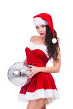Sexy young woman in Christmas wear and hat holding Stock Photos