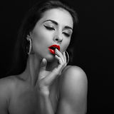 Sexy young woman with close eyes touching. The lips. Black and white portrait Stock Image