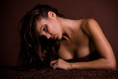 Sexy young woman in coffee beans Royalty Free Stock Images